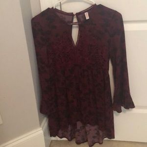 maroon lightly floral blouse